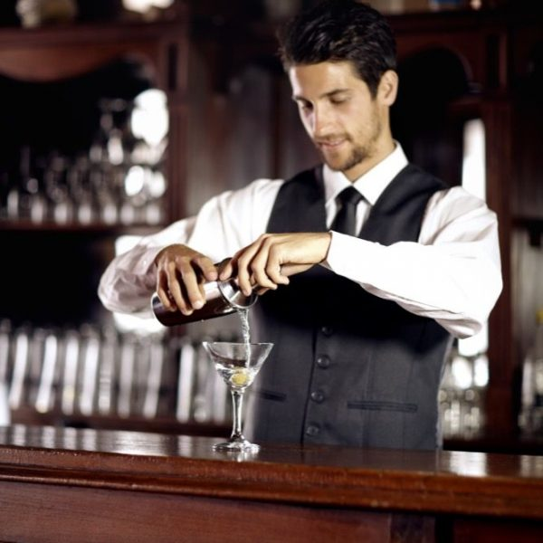 A handsome young bartender mixing a cocktail for a customerhttp://195.154.178.81/DATA/istock_collage/0/shoots/780958.jpg